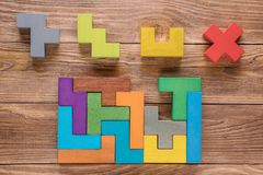 IQ test. Choose correct answer. Logical tasks composed of colorful wooden shapes. Children`s educational logical task,. IQ test. Choose correct answer. Logical Stock Photo
