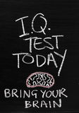 IQ Test Today. The phrase IQ Test Today written on a blackboard sign with a reminder to Bring Your Brain royalty free stock photos