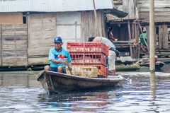 Belen neighborhood of Iquitos. IQUITOS, PERU - JULY 18, 2015: Boatmen in partially floating shantytown in Belen neigbohood of Iquitos, Peru stock photography