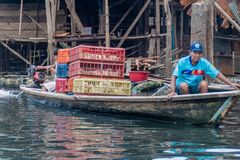 Belen neighborhood of Iquitos. IQUITOS, PERU - JULY 18, 2015: Boatmen in partially floating shantytown in Belen neigbohood of Iquitos, Peru stock images