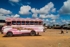 Wooden bus. IQUITOS, PERU - JULY 19, 2015: Wooden bus stays on a bus terminal in Iquitos, Peru royalty free stock photography