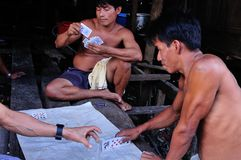 Iquitos - Peru. Play poker in palafito- Market of Belen in IQUITOS . Department of Loreto .PERU stock photos