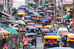 Iquitos Street Scene. IQUITOS, PERU - MARCH 17: Heavy traffic in the Belen market in Iquitos, Peru on March 17, 2015 stock image