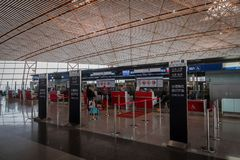 Ir China check-in counter at Beijing airport in China. Beijng, China - October 2017: Air China check-in counter at Beijing airport in China. Air China is the Royalty Free Stock Images