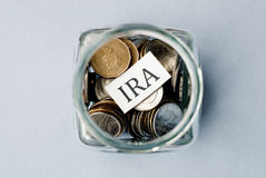 IRA. Coins in a jar with IRA label on it stock images