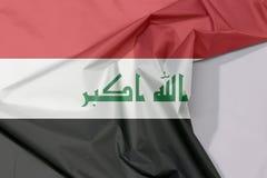 Iracka tkaniny flaga krepa i zagniecenie z biel przestrzenią obraz stock