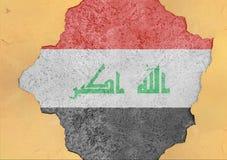 Irak flaggaabstrakt begrepp i betong för agg för fasadstruktur stor skadad arkivfoto