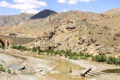 Mountain and river in Iran with orange rocks and desert around. Iranian walking stock images