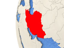 Iran on 3D globe. Map of Iran on globe with watery blue oceans and landmass with visible country borders. 3D illustration Stock Images