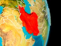 Iran on Earth. Iran in red on planet Earth with visible borderlines. 3D illustration. Elements of this image furnished by NASA royalty free stock photography