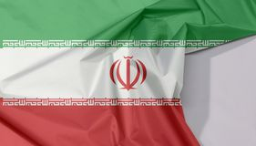 Iran fabric flag crepe and crease with white space. Iran fabric flag crepe and crease with white space, green white and red color with National Emblem and the royalty free stock images