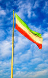 Iran flag against blue sky Stock Images