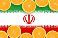 Iran flag in citrus fruit slices horizontal frame. Iran flag in horizontal frame of orange citrus fruit slices. Concept of growing as well as import and export stock illustration