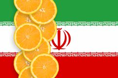 Iran flag and citrus fruit slices vertical row. Iran flag and vertical row of orange citrus fruit slices. Concept of growing as well as import and export of stock images