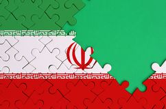 Iran flag is depicted on a completed jigsaw puzzle with free green copy space on the right side.  royalty free illustration
