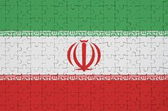 Iran flag is depicted on a folded puzzle stock illustration