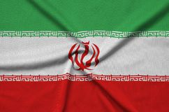 Iran flag is depicted on a sports cloth fabric with many folds. Sport team banner. Iran flag is depicted on a sports cloth fabric with many folds. Sport team stock photos