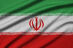 Iran flag is depicted on a sports cloth fabric with many folds. Sport team banner. Iran flag is depicted on a sports cloth fabric with many folds. Sport team stock photography