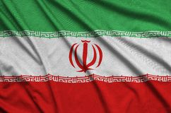 Iran flag is depicted on a sports cloth fabric with many folds. Sport team banner. Iran flag is depicted on a sports cloth fabric with many folds. Sport team royalty free stock photo