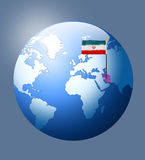 Iran flag on earth Stock Images