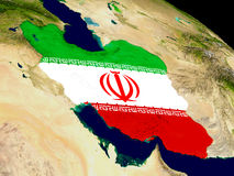 Iran with flag on Earth Stock Photo