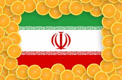 Iran flag in fresh citrus fruit slices frame. Iran flag in frame of orange citrus fruit slices. Concept of growing as well as import and export of citrus fruits royalty free stock photos