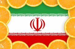 Iran flag in fresh citrus fruit slices frame. Iran flag in frame of orange citrus fruit slices. Concept of growing as well as import and export of citrus fruits royalty free stock photo