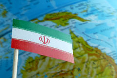 Iran flag with a globe map as a background Royalty Free Stock Photo