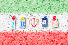 Iran flag. Message Iran made of newspaper letters, hanged with thumbtacks at cork board edited that looks like national flag stock images