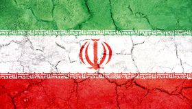 Iran flag painted on cracked ground. Closeup royalty free stock images