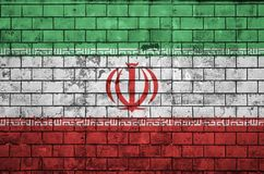 Iran flag is painted onto an old brick wall royalty free stock photos