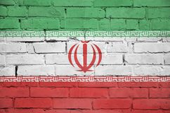 Iran flag is painted onto an old brick wall royalty free illustration