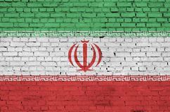 Iran flag is painted onto an old brick wall stock photos