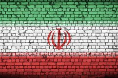 Iran flag is painted onto an old brick wall stock image