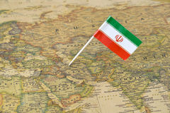 Iran flag pin on map royalty free stock image