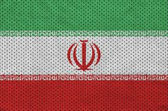 Iran flag printed on a polyester nylon sportswear mesh fabric wi. Th some folds stock photography