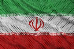 Iran flag printed on a polyester nylon sportswear mesh fabric wi. Th some folds stock images