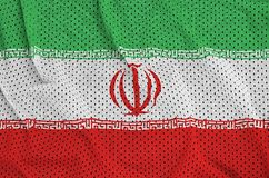 Iran flag printed on a polyester nylon sportswear mesh fabric wi. Th some folds stock photo