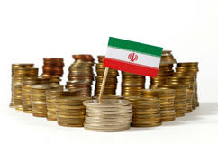 Iran flag with stack of money coins Royalty Free Stock Images