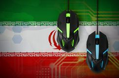 Iran flag and two mice with backlight. Online cooperative games. Cyber sport team. Iran flag and two modern computer mice with backlight. The concept of online stock photos