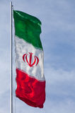 Iran Flag Waving in the Wind against Blue Sky with Copy Space Royalty Free Stock Image