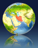 Iran on globe with reflection. Illustration with detailed planet surface. Elements of this image furnished by NASA Stock Photography
