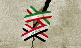 Iran and Iraq bandages over crack on wall. Stock Photography