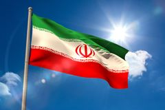 Iran national flag on flagpole Royalty Free Stock Photos