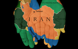Iran In Our Hands. Map Painted On Hands Showing The Concept Of Having Iran In Our Hands Royalty Free Stock Photos