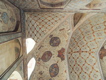 Iran palace corner with beautiful Islamic floral designs on ceiling and walls Stock Photos