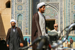 Iran, Persia, Yazd - September 2016: Local people near the mosque on the streets of the old town. Street photo. Royalty Free Stock Photography