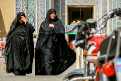 Iran, Persia, Yazd - September 2016: Local people near the mosque on the streets of the old town. Street photo Royalty Free Stock Photos