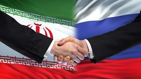 Iran and Russia handshake, international friendship relations, flag background. Stock photo stock images