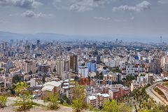 Iran, Tehran, elevated city skyline from observation deck in mountains. royalty free stock images